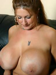 Busty bitch Summer sensually jerking a massive penis to her mouth