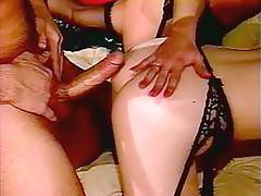 Retro guy fucking and creaming two horny ladies in stockings
