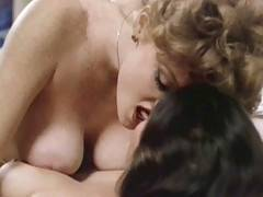 Two big breasted classic lesbians pleasing their pussies